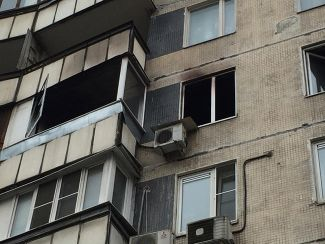 The window of the Meshcheryakovs' burned-out apartment in Moscow, where Bobokulova murdered the family's four-year-old daughter.