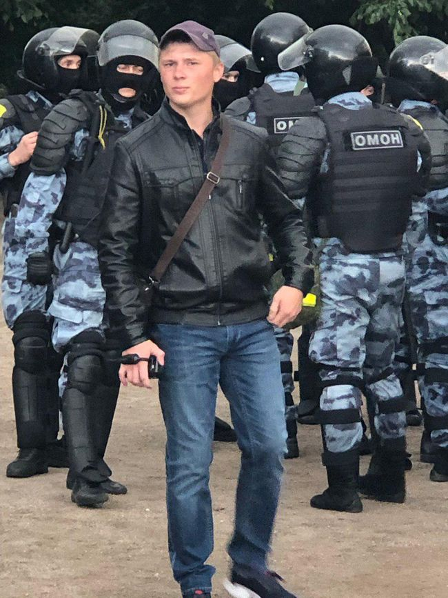 A man carries a video camera at Moscow's August 3 protest.