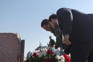 Alexander Zakharchenko and Denis Pushilin lay flowers at the memorial to the victims during a ceremony on the first anniversary of the MH17 crash, outside Grabovo.