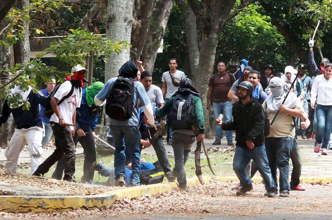 "Members of a ""colectivo"" beat an opposition student who was taking part in a protest against the government of Venezuelan President Nicolas Maduro, April 3, 2014."