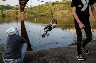 The bridge over the Vorkuta River into the abandoned town of Rudnik, where the area was originally settled. Local teens play on homemade swings from the bridge, which is now in disrepair.