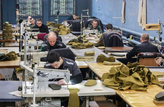 Prisoners sew World War II-style soldiers' caps for Russian Victory Day celebrations. February 2019