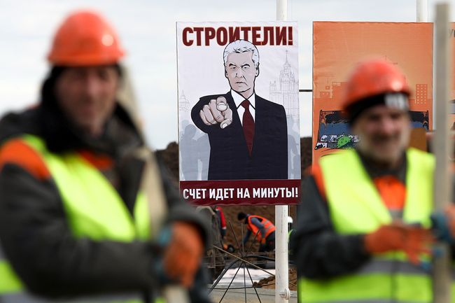 "A new hospital designed for coronavirus patients under construction in Moscow on March 21, 2020. Sign reads: ""Builders! Every minute counts!"""
