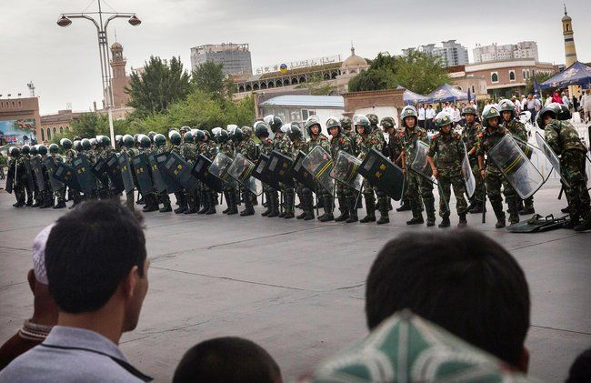 Chinese soldiers surround the central mosque of Kashgar after the death of its imam, July 30, 2014